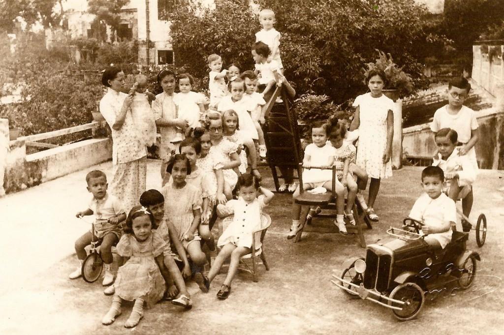 Grandchildren at grandmother's home, on terrace above garage